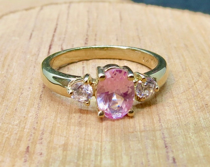 Gold morganite ring. A petite 9K yellow gold ring with 3/4 carat oval morganite with white cubic zirconia accents.