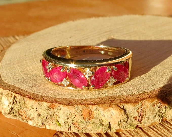 A vintage 9K yellow gold ruby and diamond ring.