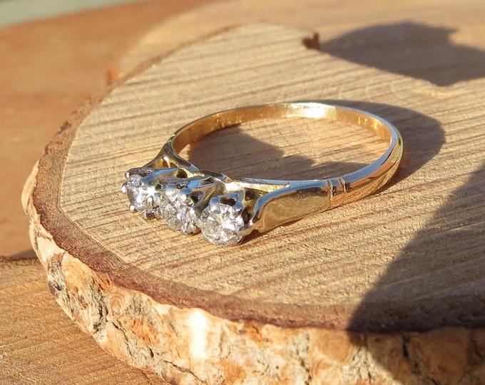 Gold diamond ring. A vintage 18k yellow gold and platinum 1/3 carat diamond trilogy ring, dates around the 1940s