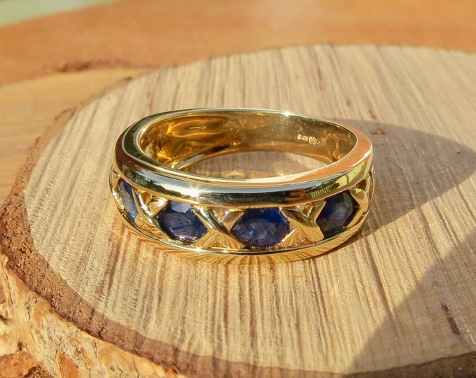 9k yellow gold 2 1/2 carat five stone sapphire ring
