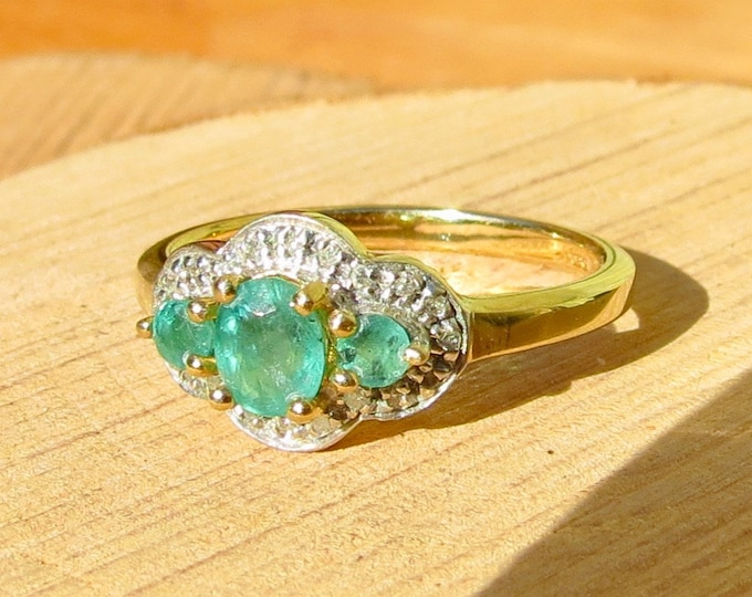 A vintage 9k yellow gold 2/3 Carat emerald trilogy ring