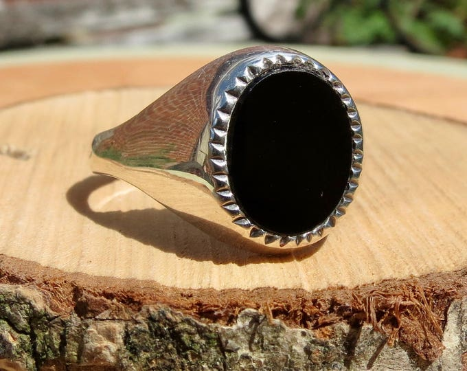 A vintage sterling silver black agate ring