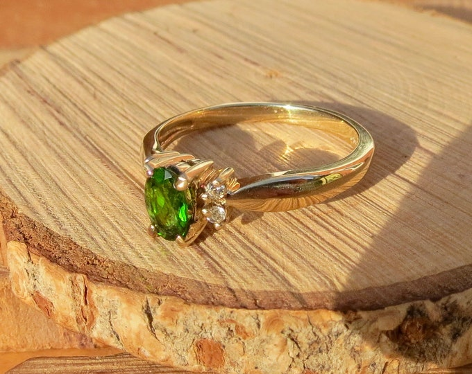 A 9k yellow gold chrome diopside and diamond ring