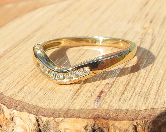"""Gold diamond ring. A 9k yellow gold """"wishbone"""" and diamond ring, to fit up against a solitaire or cluster ring. Petite size."""