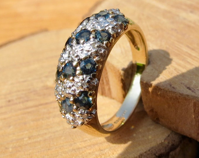 Gold sapphire ring. A 9k yellow gold diamond and sapphire cluster ring