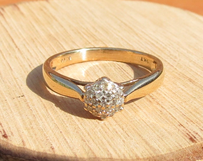 Gold diamond ring. A 9k yellow gold 1/10 carat diamond cluster ring.
