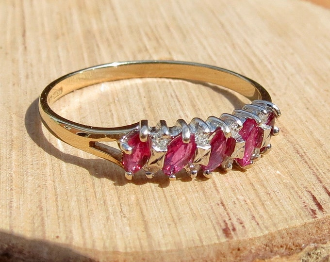 Gold ruby ring. A 9K yellow gold ring, with marquise cut pink rubies and diamond accents