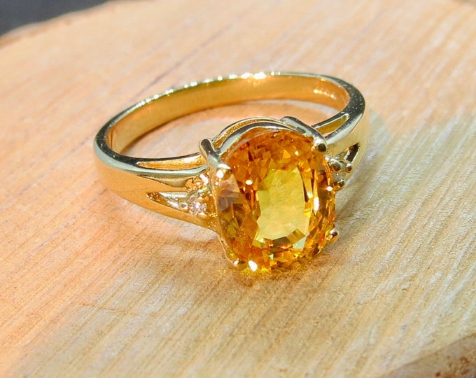 18k yellow gold ring with a 2 carat yellow sapphire and diamond accents.