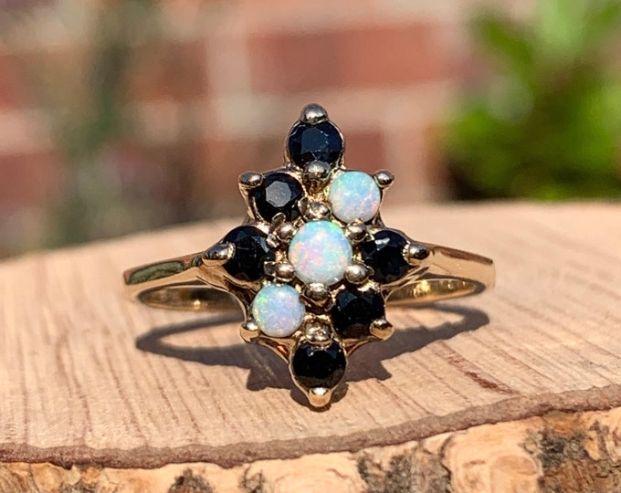 Gold opal ring. A 9k yellow gold opal and sapphire ring.