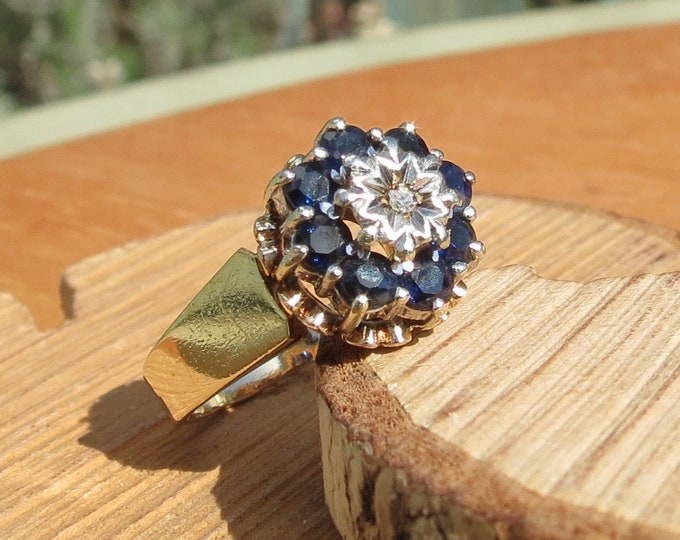 Gold sapphire ring. A 9K yellow gold sapphire and diamond ring with 1970s hallmark.