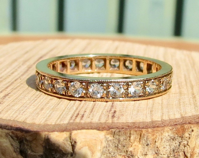 A 9K yellow gold white stone full eternity stacker ring.