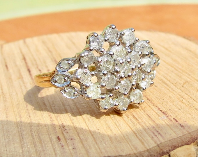 A 1 carat diamond cluster in a 9k yellow gold ring.