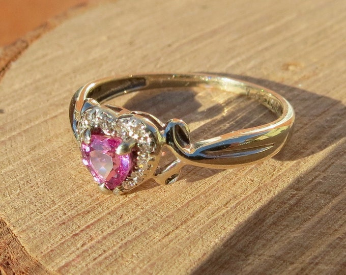 Petite 9k white gold heart cut pink sapphire and diamond halo ring.