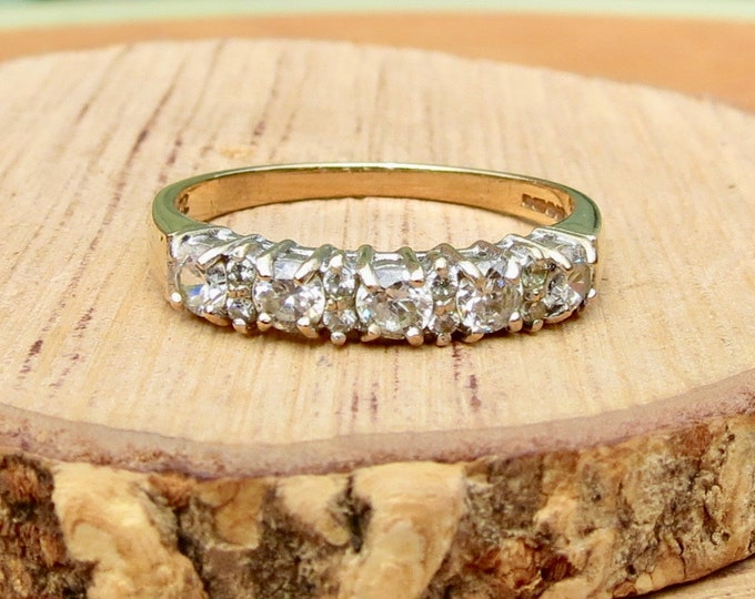 A 9K yellow gold cubic zirconia stacker ring.
