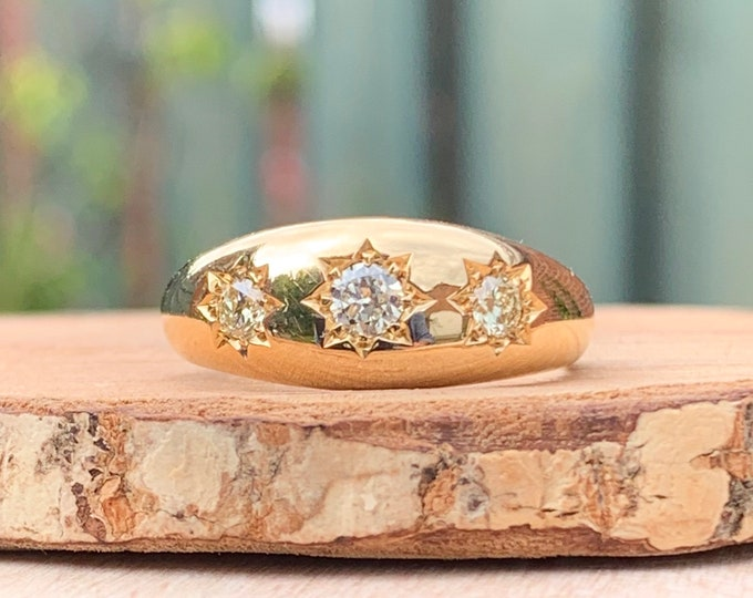 Gold diamond ring. Antique 18k yellow gold 0.40 carat graduated 'old mine cut' diamond trilogy gypsy ring. Date of hallmark 1918