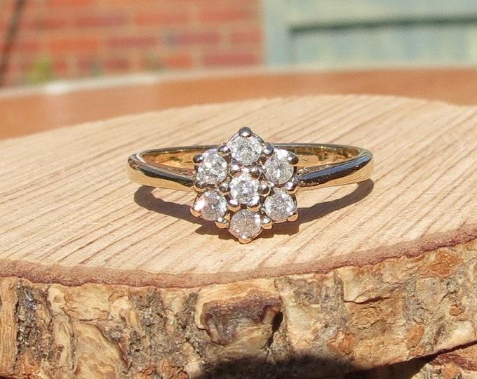 Gold diamond ring. 9K yellow gold 1/3 carat, 7 diamond cluster ring.