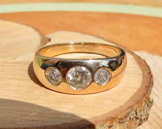 A big 14K yellow gold 1 carat diamond trilogy ring