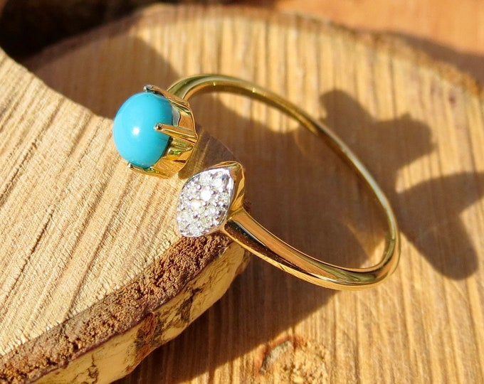 Gold turquoise ring. A fine 10k yellow gold turquoise and diamond ring