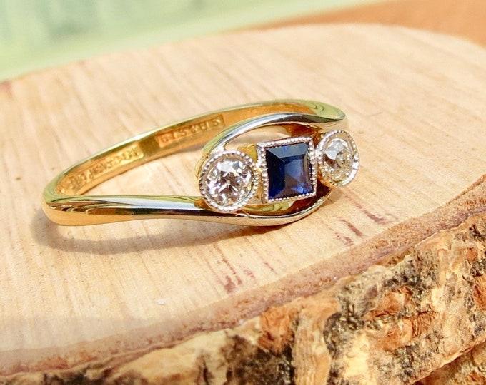 Art deco platinum & 18k yellow gold sapphire and diamond ring.