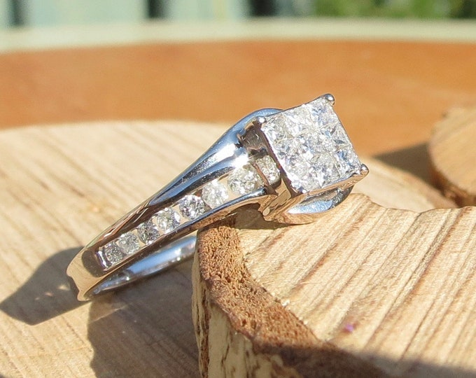 Gold diamond ring. An 18k white gold 2/3 Carat princess cut diamond ring.