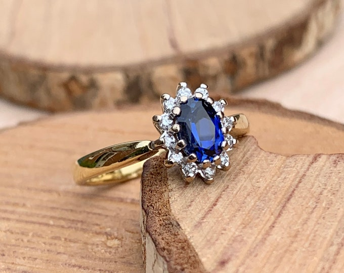 Gold sapphire ring. 18K yellow gold 2/3 carat sapphire and diamond ring.