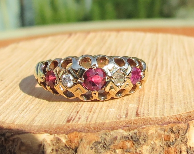 Gold ruby ring. A 9K yellow gold diamond and ruby ring.