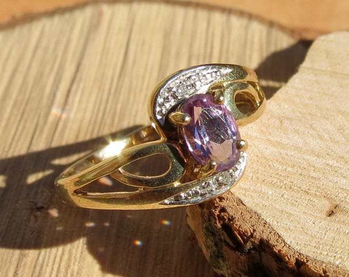 A vintage 9k yellow gold amethyst and diamond accented ring