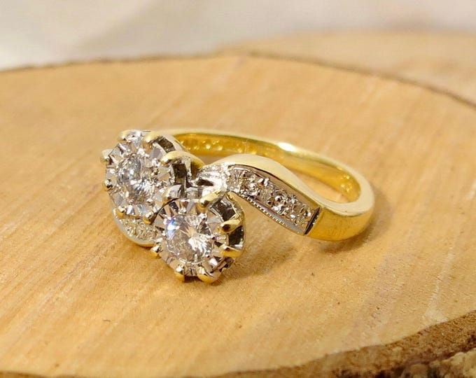 Small sized 18k yellow gold twin 1/4 carat diamond crossover ring. Free Resizing