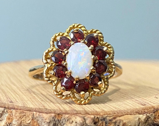 Gold opal ring. 9K yellow gold red garnet and opal ring, hallmarked 1973