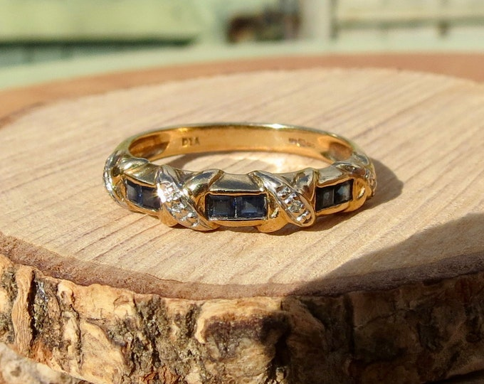 9k yellow gold ring with sapphires and diamonds.