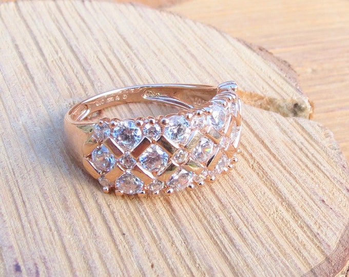 Gold CZ ring. A 14K Rose gold cubic zirconia stacker ring.