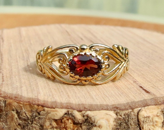 A 9K yellow gold red garnet ring