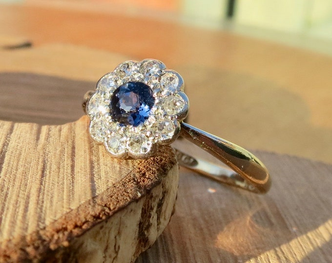 Gold sapphire ring. Antique 18K yellow gold and platinum 1/2 carat sapphire and diamond ring.