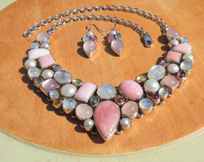 Silver gemstone set. A Silver necklace and earnings, with a pearls, rose quartz, tourmalines, moonstones, and pink opals.