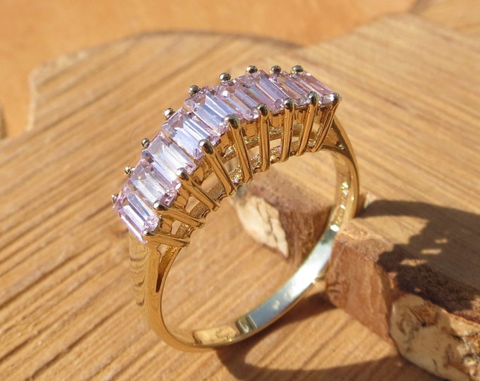 Gold CZ ring. A 9K yellow gold 1 carat baguette cut pink cubic zirconia ring.
