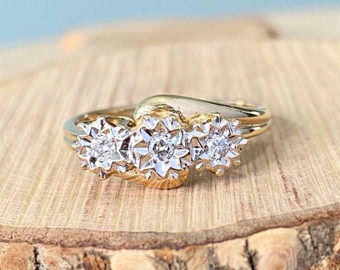 Gold diamond ring. An 9k yellow gold diamond trilogy ring