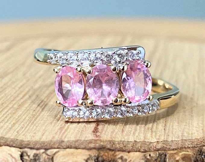 Gold spinel ring. 10K yellow gold pink spinel and white zircon ring