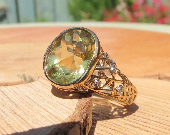 Gold quartz ring. 3 carat lemon green quartz with diamond accents.