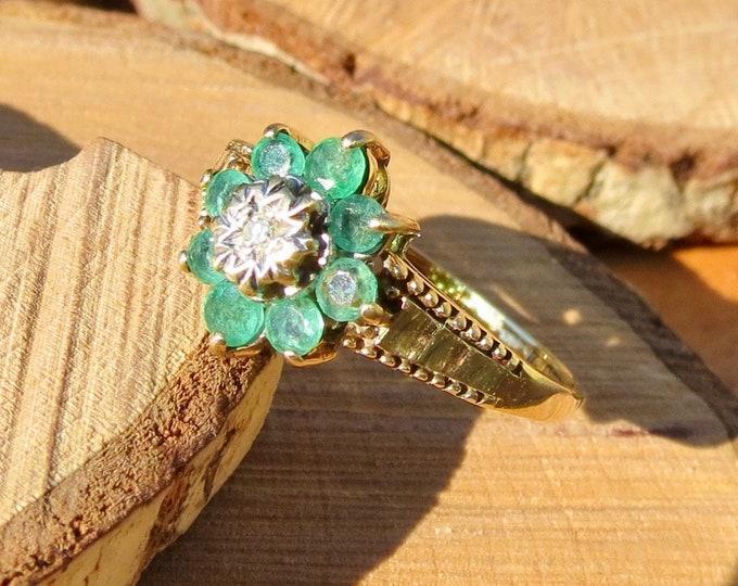 9K yellow gold emerald and diamond daisy ring.