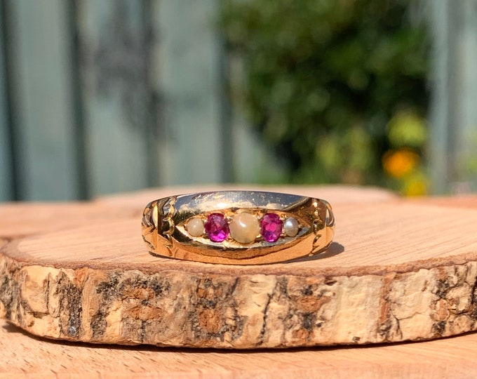 Gold ruby ring. Antique 18K yellow gold ruby and pearl ring,  Made in the year 1900 Victorian.