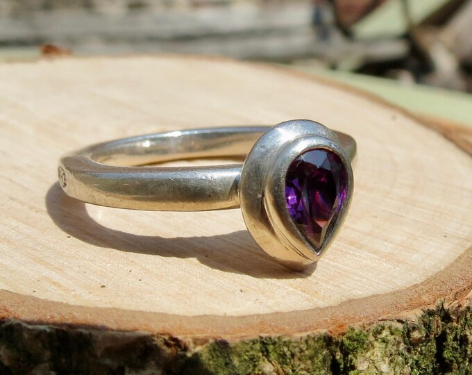 A vintage silver pear cut amethyst ring