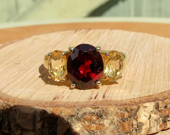 A 9K yellow gold citrine and red garnet ring.