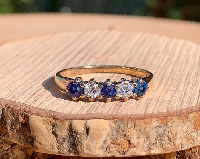 Gold sapphire ring. A 9K yellow gold sapphire and diamond ring.