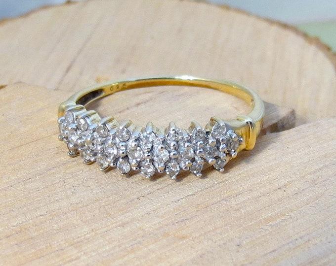 A fine vintage 9k yellow gold 1/4 carat diamond ring.
