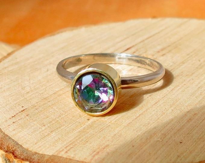Silver ring, mystical topaz.