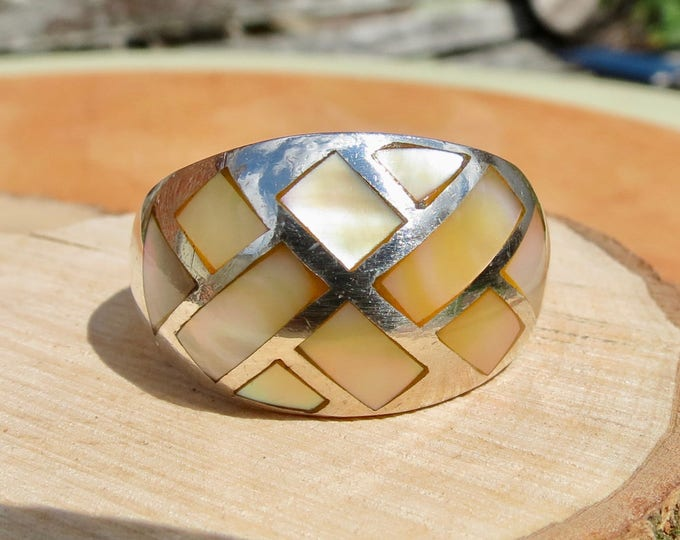 Silver pearl ring, inlaid mother of pearl plaques in a wide setting.
