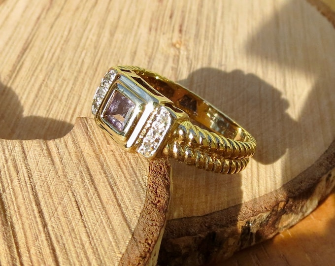A 9k yellow gold, iolite and diamond ring