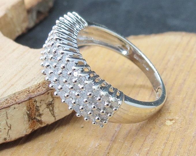 Gold diamond ring. 9K white gold one carat diamond cluster ring.