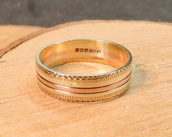 Three gold band. White yellow and rose 9K gold, wide band.