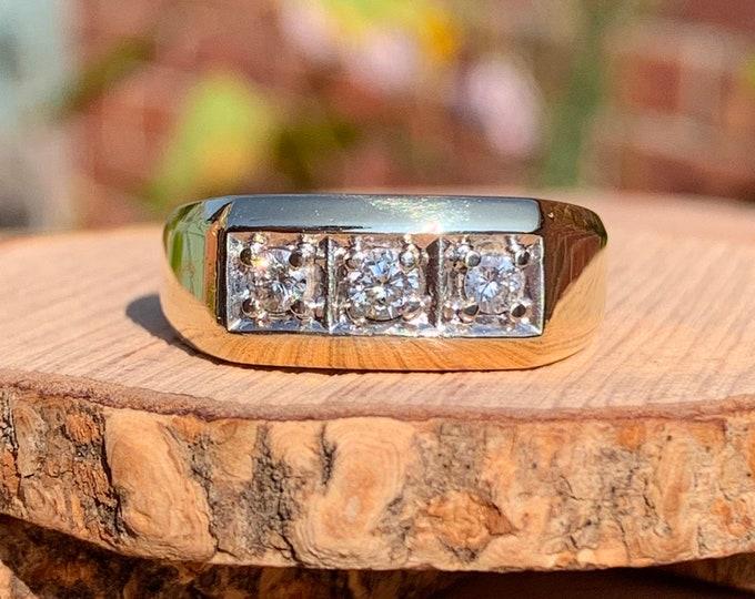 Gold diamond ring. A big vintage 9K yellow gold triple 1/3 carat diamond ring.